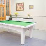 Dining room pool table with white wood